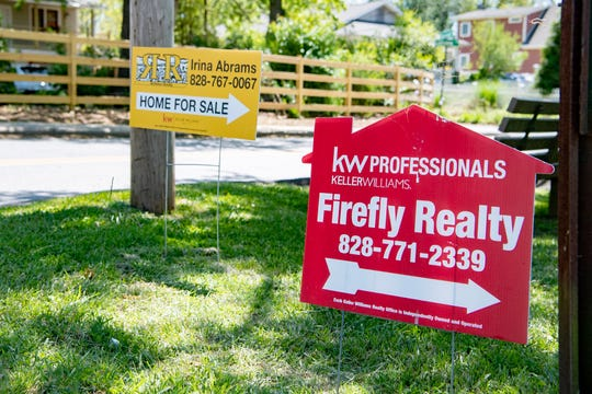 Homes under $350,000 remain in high demand and sell quickly in the Asheville region. This sign advertised a home for sale in the Oakley neighborhood in Asheville on May 11, 2020.