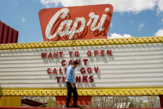 Michael Magocs, manager of Capri Drive-In Theater, adjusts marquee letters on Tuesday, May 12, 2020 in Coldwater, Mich. Although Gov. Whitmer's executive order calls for drive-in movie theaters to remain closed, the Magocs family is making plans to open soon.