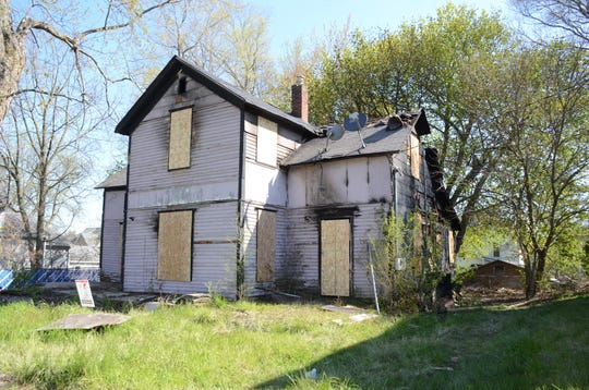 Investigators are looking for the people who burned this house at 23 Janoah Avenue on Friday.  Trace Christenson/The Enquirer