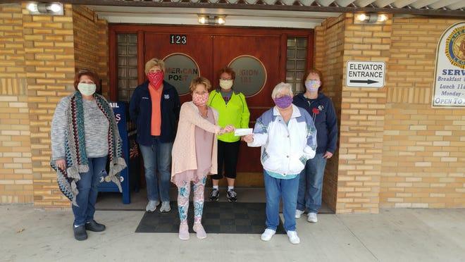 Auxiliary members BrandyRobertson, presidentKarenWeir, Tami Tima, Sue Adams, Sandi Fahl and Alice Teynor wearing their masks and social distancing.