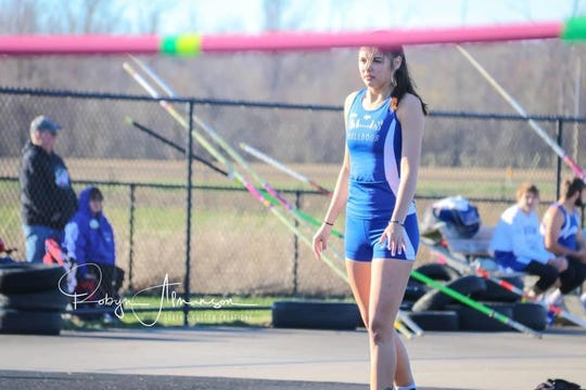 Kennedy Moore had a love-hate relationship with track and field as a runner and jumper.