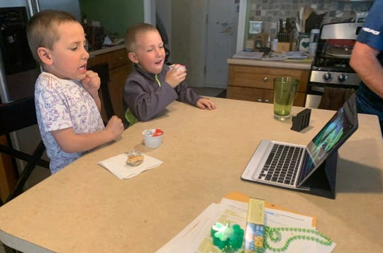 Essex Elementary School students from Ms. Clark's class engage in remote learning by watching a video about venus flytraps. Keeping young kids engaged during distance learning has been a challenge for schools and families during the pandemic, May 2020.