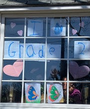 Hiawatha Elementary second graders in Mrs. Hultgren's class were challenged to create a special message to the community and hang on their window. The remote learning assignment was to provide encouragement during the COVID-19 pandemic in May 2020.