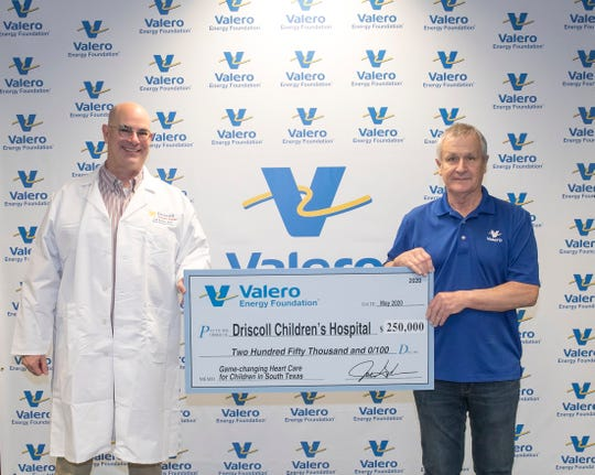 At left, Dr. Lee Budin, Chief Medical Officer, Driscoll Health System and Dennis Payne, Vice President and General Manager, Valero Bill Greehey Refineries. The Valero Energy Foundation on Tuesday announced a $250,000 donation for Driscoll Children's Hospital.