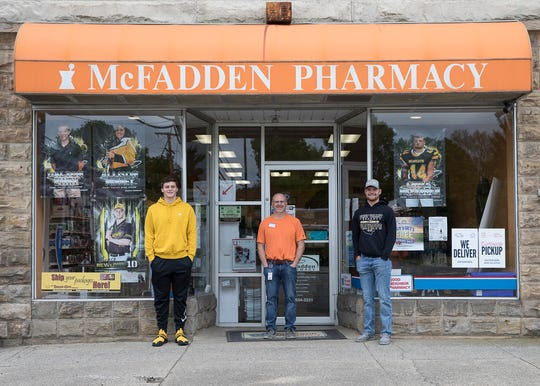 Area pharmacist and business owner Casey McFadden displays several senior banners in his business window, including his son Cruz McFadden and Bryce Newland. Several Bainbridge downtown businesses hung up senior signs and banners to show their support.