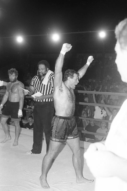 """""""Rockin'"""" Rod Bensonhaver, right, reacts to his unanimous decision over Jerry """"Mad Dog"""" Hamlin. The second annual Toughman/Toughwoman Contest was held at the Ross County Fairgrounds in July 1993."""