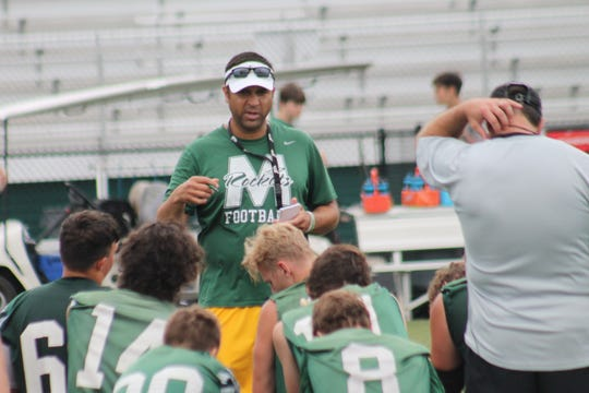 McNicholas coach Mike Orlando instructs his troops after a recent practice. The Rockets will host their first-ever game under the lights at Penn Station Stadium on Aug. 24 against Goshen. Scott Springer/The Enquirer McNicholas coach Mike Orlando instructs his troops after a recent practice. The Rockets will host their first-ever game under the lights at Penn Station Stadium on Aug. 24 against Goshen.