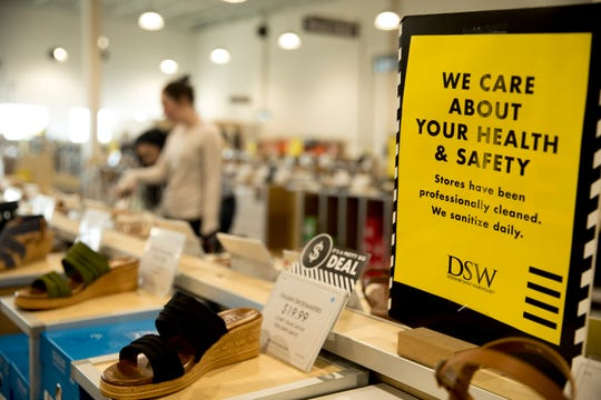 A sign reminding people that DSW Shoe Warehouse is cleaned and sanitized daily at DSW Shoe Warehouse on Tuesday, May 12, 2020, in Springdale. Tuesday was the first day retail stores could reopen to shoppers after being closed due to the new coronavirus pandemic.