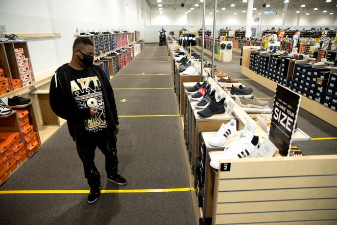 Tristan Smith, of College Hill, walks through DSW Shoe Warehouse on Tuesday, May 12, 2020, in Springdale. Tuesday was the first day retail stores could reopen to shoppers after being closed due to the new coronavirus pandemic.