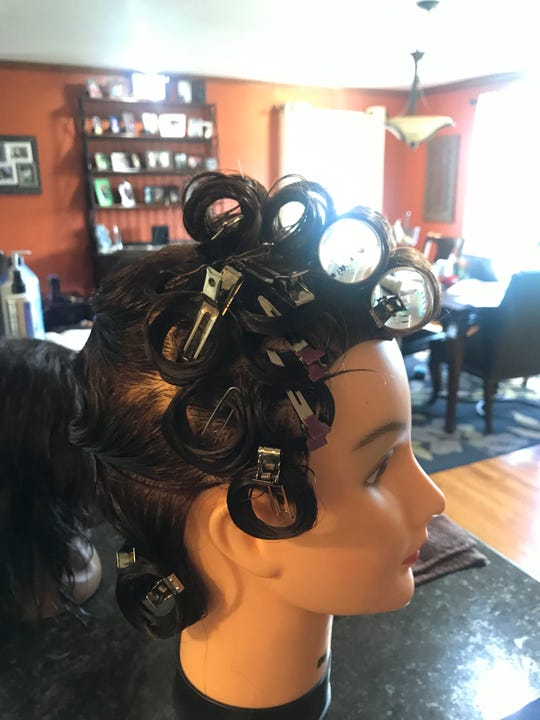 A paperclip and bobby pin are used to secure pin curls and rollers.