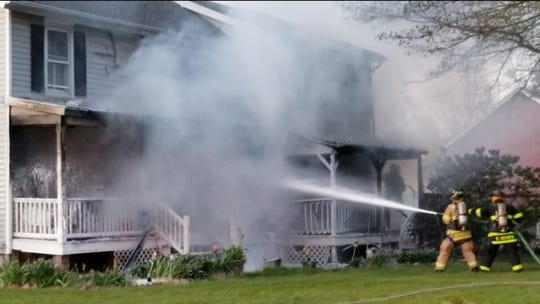 The fire at the 100-year-old home in South Brunswick was put under control in about 20 minutes.