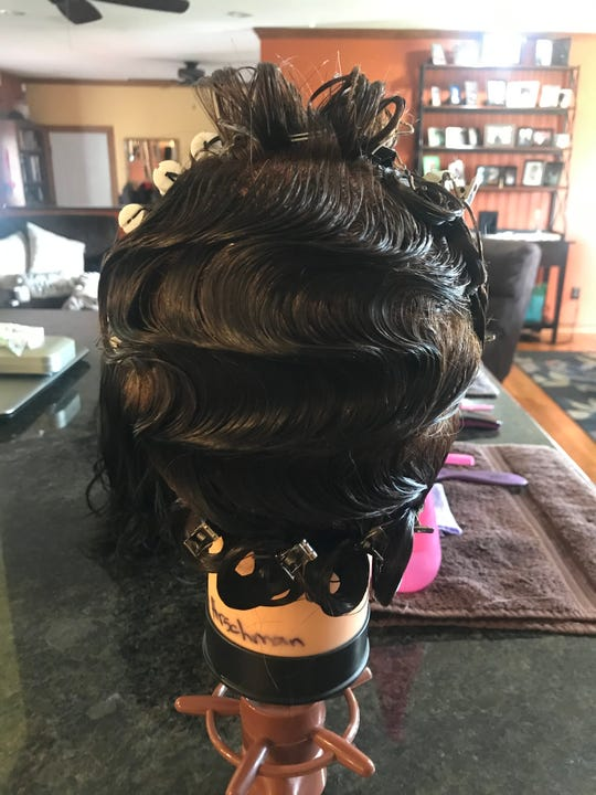 Shampoo is used in place of gel for the finger waves.