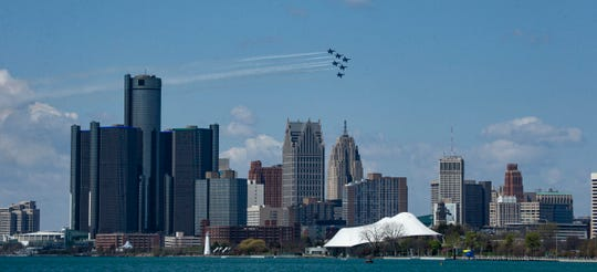 The U.S. Navy Blue Angels streak by against the Detroit skyline Tuesday, May 12, 202,0 to pay tribute to frontline workers amid the coronavirus outbreak.