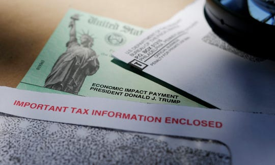 Economic Impact Payment checks will continue to be mailed in May and run through June, and possibly later. In this April 23, 2020, President Donald Trump's name is seen on a stimulus check issued by the IRS to help combat the adverse economic effects of the COVID-19 outbreak, in San Antonio.  (AP Photo/Eric Gay, File)