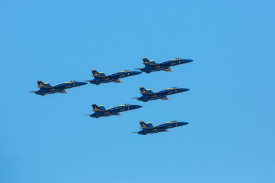The U.S. Navy Blue Angels fly over Metro Detroit, Michigan on Tuesday, May 12, 2020 to honor coronavirus essential workers.
