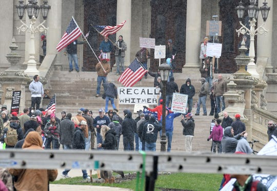 People protest Gov. Gretchen Whitmer's new executive orders April 15 on the Capitol steps.