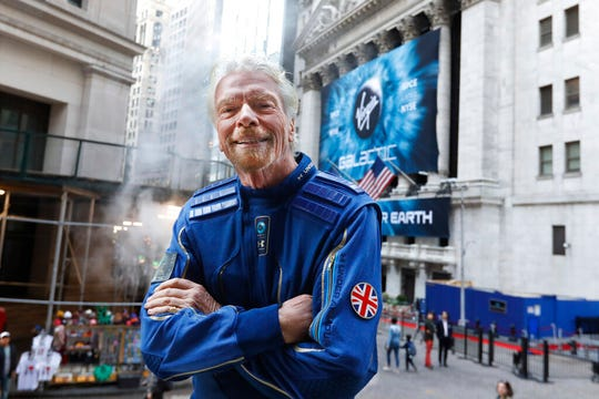 Sir Richard Branson, founder of Virgin Galactic, poses for a photo outside the New York Stock Exchange before his company's IPO, Monday, Oct. 28, 2019.