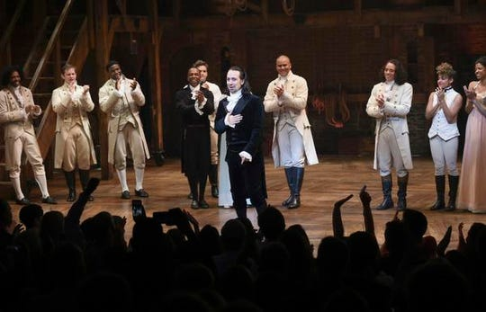 """FILE - This July 9, 2016 file photo shows actor and """"Hamilton"""" creator Lin-Manuel Miranda, center, takes his final performance curtain call at the Richard Rogers Theatre in New York. The Walt Disney Company said Tuesday, May 12, 2020, it will offer the live capture of Miranda's show on Disney TV Plus starting on July 3. It had been slated to be in movie theaters in October, 2021. (Photo by Evan Agostini/Invision/AP, File)"""