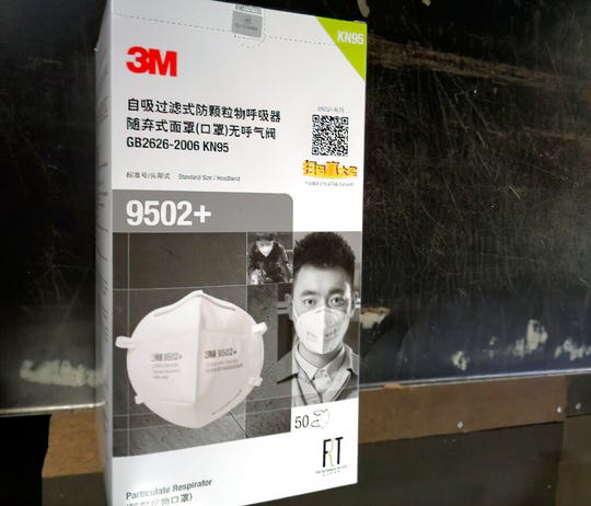 In this image provided by the U.S. Immigration and Customs Enforcement, this March 3, 2020, photo, shows counterfeit 3M masks that were confiscated at the Cincinnati LUK airport in Cincinnati.