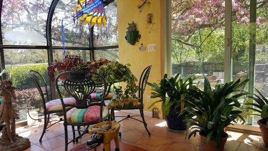 "Linda Shears of Linda Shears Designs calls her garden room her ""ah"" room."