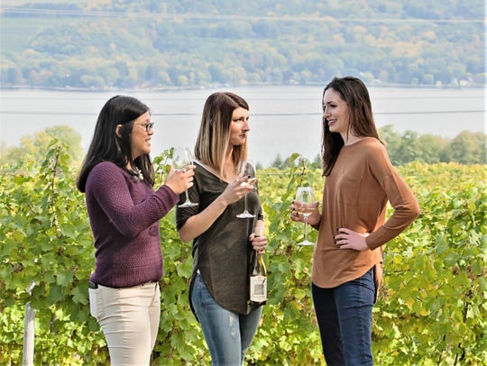 Visitors enjoy the view and a glass of Sauvignon blanc at Fulkerson Winery on the west shore of Seneca Lake, north of Watkins Glen.