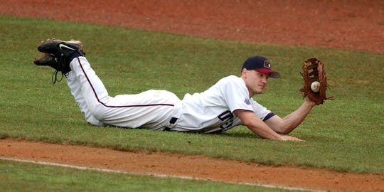 Jeff Goldbach, then playing first base for the Otters, makes a diving catch on a pop fly.