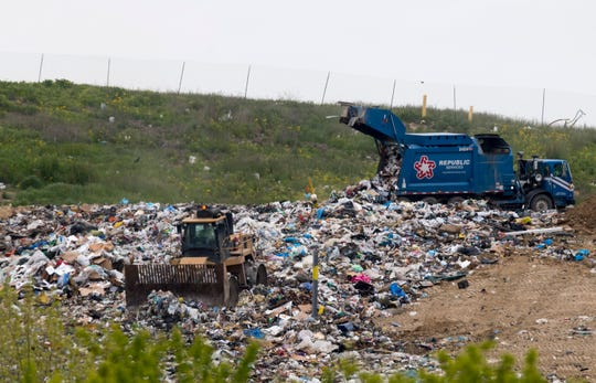 Workers move garbage at Laubscher Meadows Landfill off St. Joseph Avenue Tuesday morning, May 12, 2020. Vanderburgh County Commissioners voted 3-0 to build a bridge to allow the landfill to transfer dirt beneath North St. Joseph Tuesday morning.