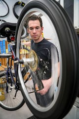 Greg Sharp, bike mechanic, works on a bike for a customer at Paradise Bicycles. Bike shops in Lee County are one of the few businesses booming since the coronavirus pandemic began to the point of there being bike shortages. Bike mechanics at Paradise Bicycles in Fort Myers are working hard on the backload of bikes. Repairs are taking around a week to 10 days for most bikes and their inventory of new bikes fly out the door the day they are delivered.
