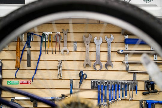 Tools used to repair bikes hang on the wall at Paradise Bicycles. Bike shops in Lee County are one of the few businesses booming since the coronavirus pandemic began to the point of there being bike shortages. Bike mechanics at Paradise Bicycles in Fort Myers are working hard on the backload of bikes. Repairs are taking around a week to 10 days for most bikes and their inventory of new bikes fly out the door the day they are delivered.