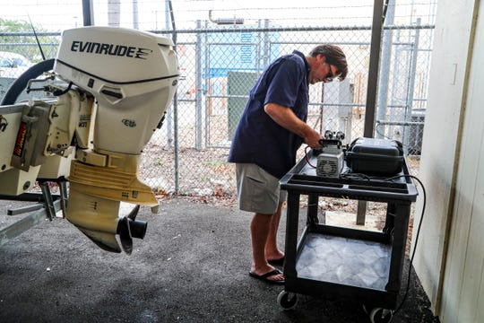 Mike Parsons, professor of Marine Science, Water School at FGCU, prepares to install an air sampler in Cape Coral. FGCU is putting out air samplers to look for algae in the Cape  to monitor conditions right now, remotely, so they can catch things they're not seeing everyday once the algae starts. This round of testing will show them what conditions look like before a bloom starts. They are interested in knowing what the air is doing just as a bloom happens, as well as what toxins are in the air as a bloom is going on.