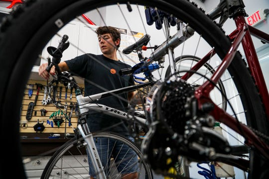Nick Boyce, bike mechanic, works to repair a bike for a customer. Bike shops in Lee County are one of the few businesses booming since the coronavirus pandemic began. To the point of there being bike shortages. Bike mechanics at Paradise Bicycles in Fort Myers are working hard on the backload of bikes. Repairs are taking around a week to 10 days for most bikes and their inventory of new bikes fly out the door the day they are delivered.
