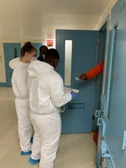 State National Guard soldiers help efforts to monitor inmates and check temperatures amid the coronavirus pandemic.