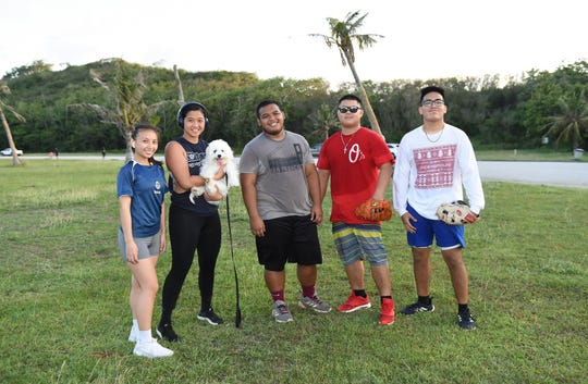 A group of friends make a visit to Asan Beach Park on May 12, 2020. From left: Tamika Ballesta, Rena Campo, Jonah Perez, Corey Duenas, and Nathan Perez.
