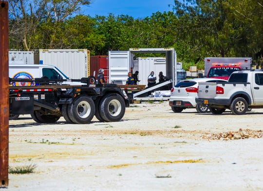 Guam Fire Department personnel, Customs and Quarantine Agency officers and other emergency responders gather near an open shipping container after an industrial accident at a site with Landscape Management Systems vehicles, across the street from the Micronesia Mall on Marine Corps Drive in Dededo, on Tuesday, May 12, 2020. Three workers and a Customs officer were reportedly trapped under a steel wall in the container and had to be extricated using the Jaws of Life and airbags, before being transported to the Guam Regional Medical City, said GFD spokesman Kevin Reilly.