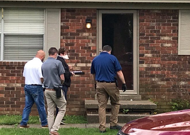 Henderson police and the Henderson County Coroner's Office on the scene of a death investigation on Peggy Drive (May 11, 2020).