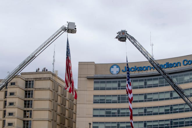 The Madison County fire department raise two American flags at Jackson-Madison County General Hospital in honor of the front line workers in Jackson last year. Ayers Children's Hospital is inside the general hospital.