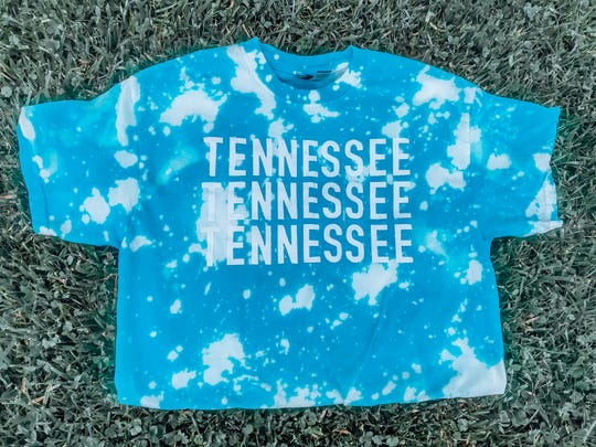 """Nashville-based label Game Day Dye bleaches designs on team shirts and approached Tanna Hensley at Ktown Designs to collaborate for a giveaway. """"I printed the Tennessee design on her bleached shirts and people wanted more of them,"""" said Hensley."""