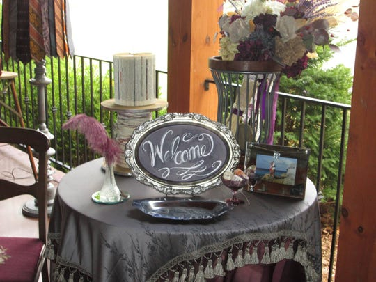 Beautiful table decor set up on the porch of Chez Lily Events.