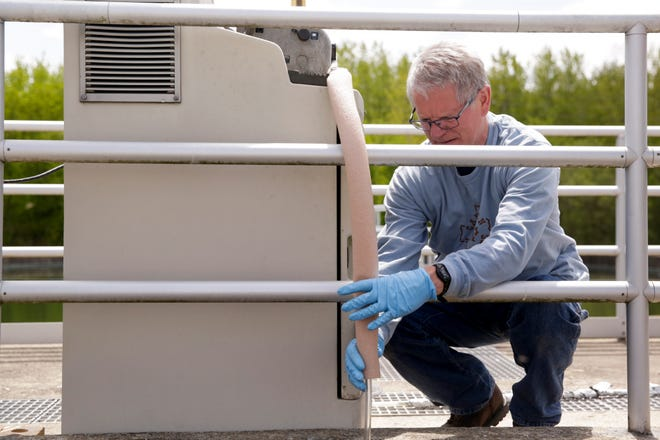 Steve Tice, lab manager at the West Lafayette Wastewater Treatment Plant, hooks up a tube for testing, Tuesday, May 12, 2020 in West Lafayette.