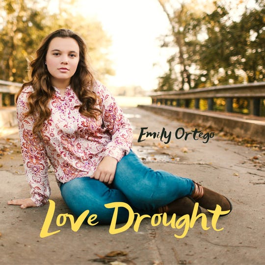 Emily Ortego, a 20-year-old, recently released her first album, Love Drought. The Opelousas native received a golden ticket in American Idol season 17 with her original song 'So I Sing,' with lyrics she created at South Louisiana Songwriters Festival and Workshop. This song is included in her album, where the common thread of lacking love whether that bematernal love, romantic love, or friendships flows between songs.