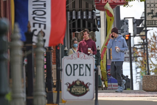 Shoppers could find a handful of stores, such as Carrousel Antiques, open on Main Street Tuesday as Ohio businesses begin to reopen, nearly two months after being closed due to the coronavirus pandemic.