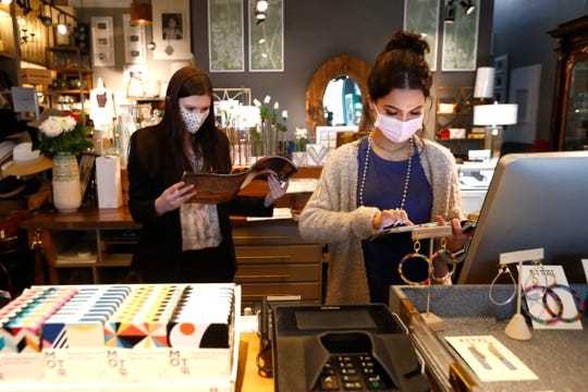 Mary Grace Payne, left, and Heather Mize work behind the counter at Southern Avenue Company inside the Shops of Saddle Creek in Germantown on Tuesday, May 12, 2020.