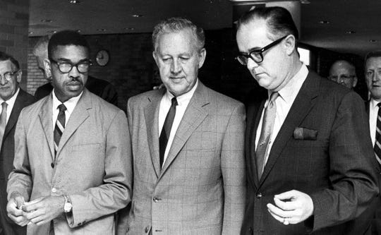 June 23, 1969 - Lawrence Cox (center), assistant secretary of the U.S. Department of Housing and Urban Development, announced funding approval for the Beale Street Urban Renewal Project.  Mr. Cox was escorted to a press conference by City Councilman Fred Davis (left) and Representative Dan Kuykendall (R.-Tenn.)