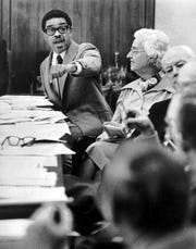 March 18, 1975 - City Councilman Fred Davis (left) makes a point during a council meeting on March 18, 1975.  At right are fellow council members Gwen Awsumb and Bob James.  Davis, an insurance executive, left the council in 1979 after serving for 12 years.