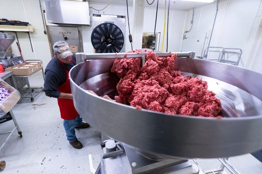 Rich Dobrzynski works on packaging ground beef May 11 at Johnson's Sausage Shoppe & Catering in Rio. As of mid-May, owner Chris Johnson was backed up with meat processing orders into December because large meat processors were struggling with the corona virus pandemic.