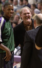 Milwaukee Bucks Ray Allen and coach George Karl share a laugh before the start of a game in October 2000 at the Bradley Center. The two were key components in the Bucks' run to the Eastern Conference finals. But both were both gone two seasons later.