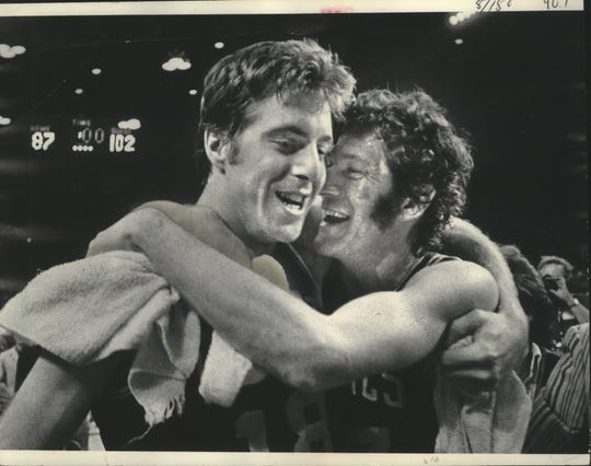 Dave Cowens (left) and John Havlicek celebrate the 1974 NBA championship at the Milwaukee Arena.