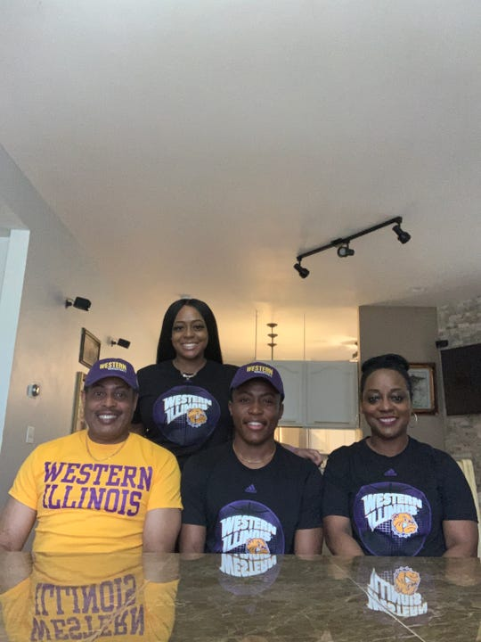 Milwaukee Golda Meir senior Matthew Wade (center) poses with his family after accepting an invitation to walk-on to Western Illinois' men's basketball program.