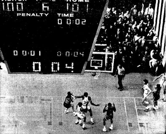 An overhead shot shows the aftermath of Kareem Abdul-Jabbar's game winner against the Celtics in Game 6 of the 1974 NBA Finals.