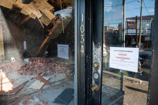 A condemned sign on the door after an interior collapse at a store fronts on Fairview Ave. in Cloverdale neighborhood in Montgomery, Ala., on Tuesday, May 12, 2020.